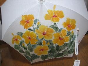 黄色いハイビスカスの花の絵のパラソル